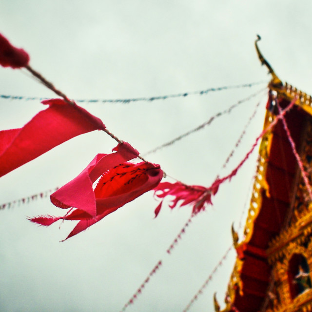"""""""Thailand Wat With Waving Red Prayer Flags"""" stock image"""