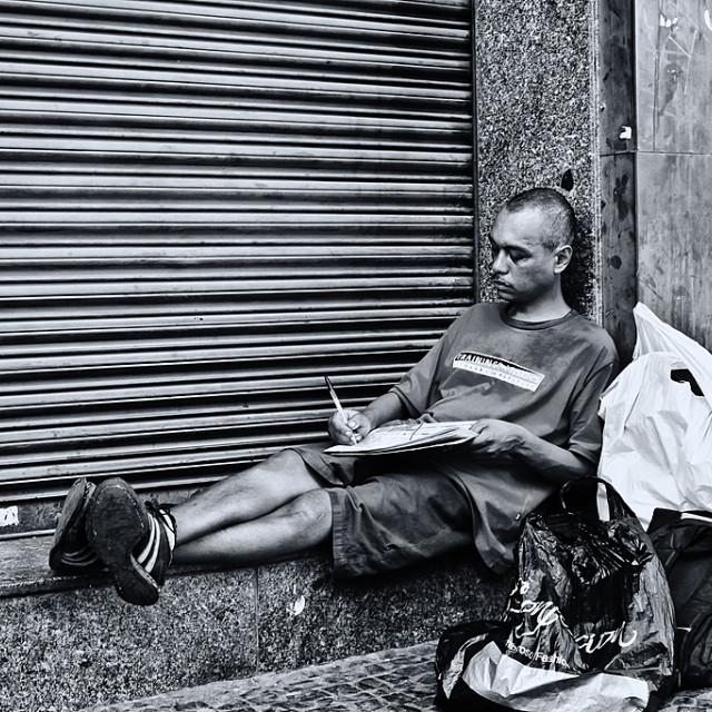 """""""Beggar reader"""" stock image"""