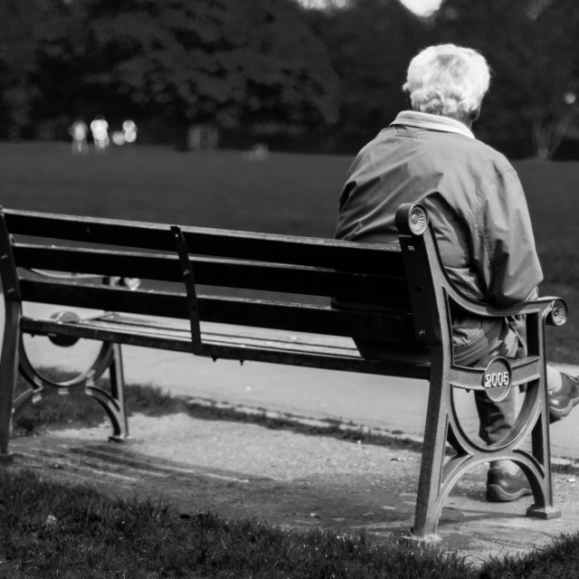 """Old man on bench"" stock image"