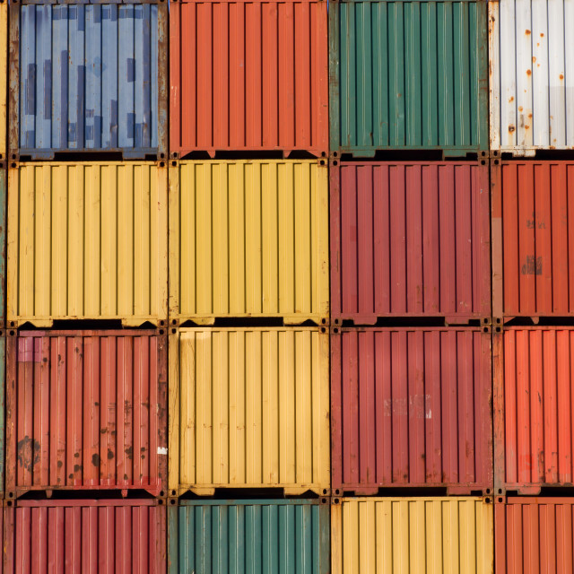 """Colourful ship cargo containers stacked up in a port."" stock image"