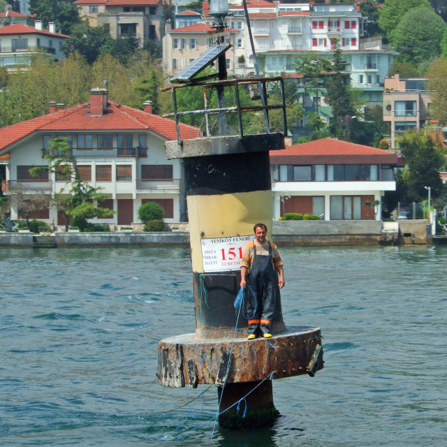 """Bloke on a Buoy in the Bosphorus"" stock image"