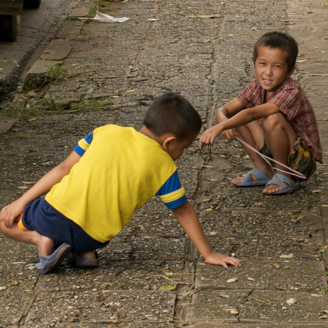 """Boys playing in Luang Prabang, Laos"" stock image"