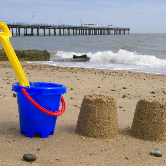 """Kids bucket, spade and sandcastles on Felixstowe beach."" stock image"