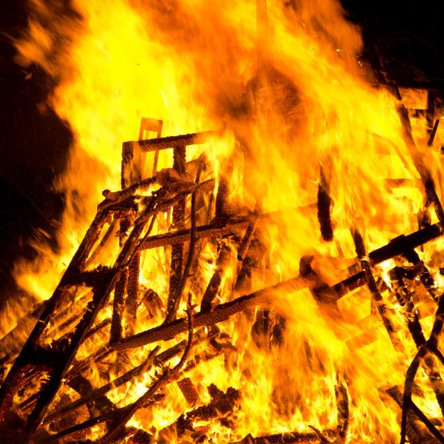 """Bright burning wood outside bonfire flames."" stock image"