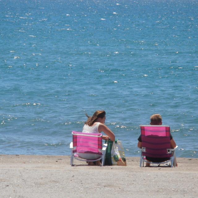 """""""Couple on Empty Beach"""" stock image"""