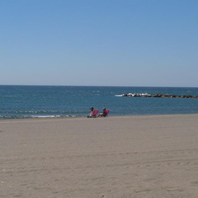 """Couple on Empty Spanish Beach"" stock image"