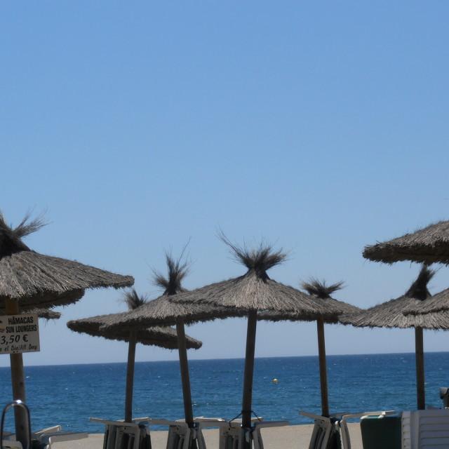 """Spanish Parasols & Sun Loungers"" stock image"