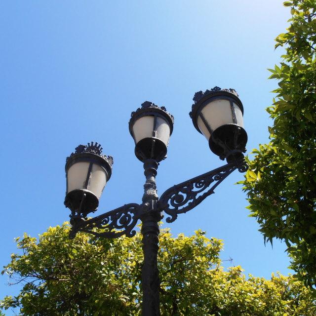 """Spanish Wrought Iron Street Lights"" stock image"