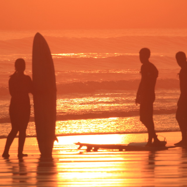 """Sunset Surfers"" stock image"