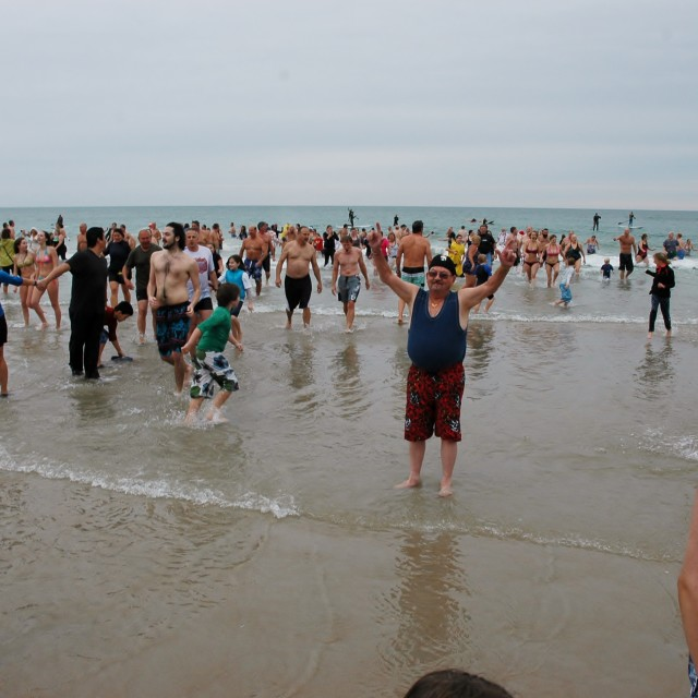 """Swimmers at Dolphin Dip"" stock image"