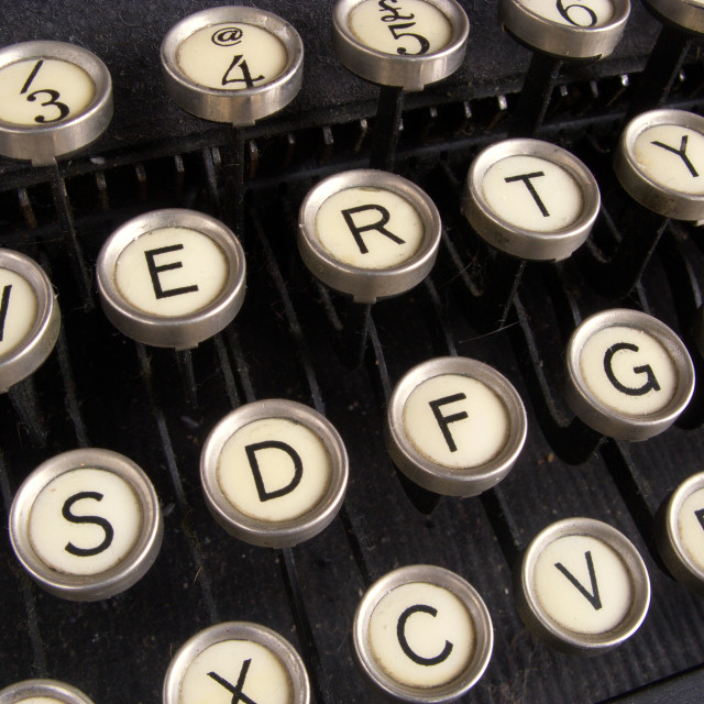 """Close up of keys on a dirty old nicotine stained typewriter."" stock image"