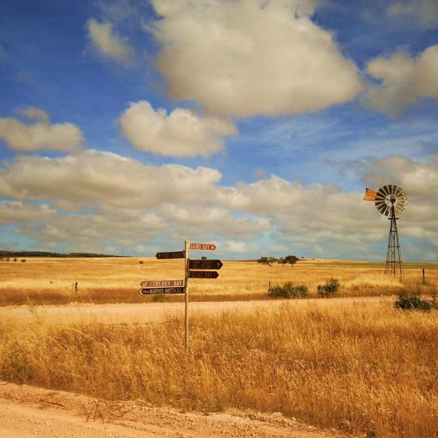 """Crossroads in farm land"" stock image"