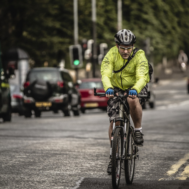 """A man cycling to work"" stock image"