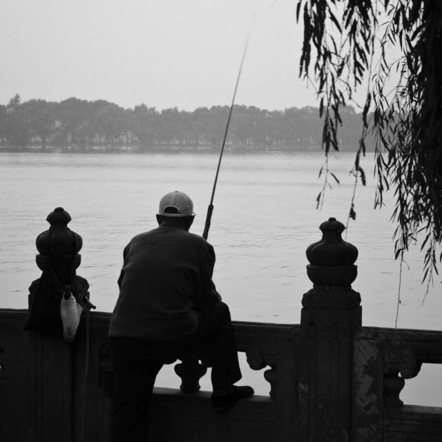 """""""Man fishing, Beijing"""" stock image"""