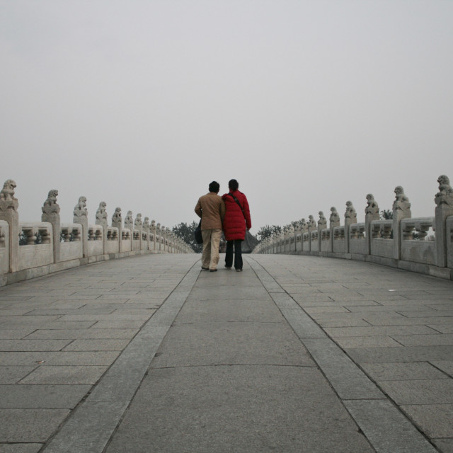 """Couple on 17 Arch Bridge, Beijing"" stock image"
