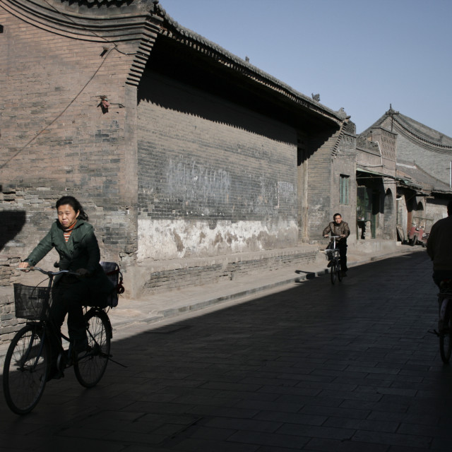 """Cycling in Ping Yao, China"" stock image"