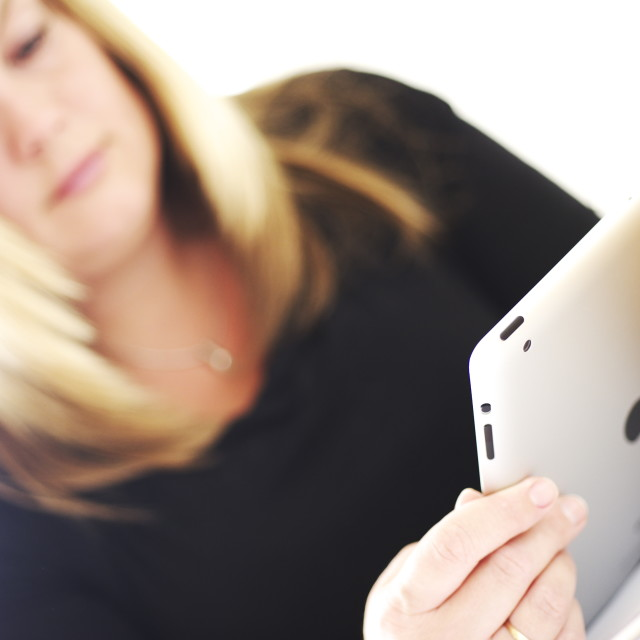 """""""Young woman using tablet"""" stock image"""