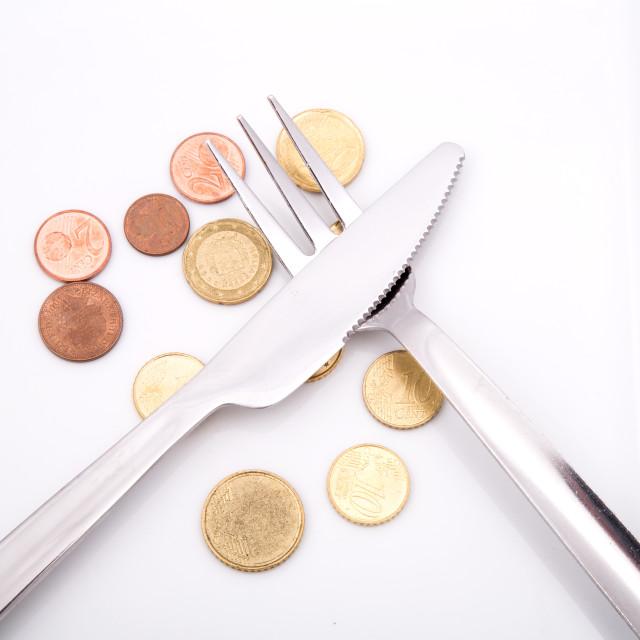"""""""Eating Euros"""" stock image"""
