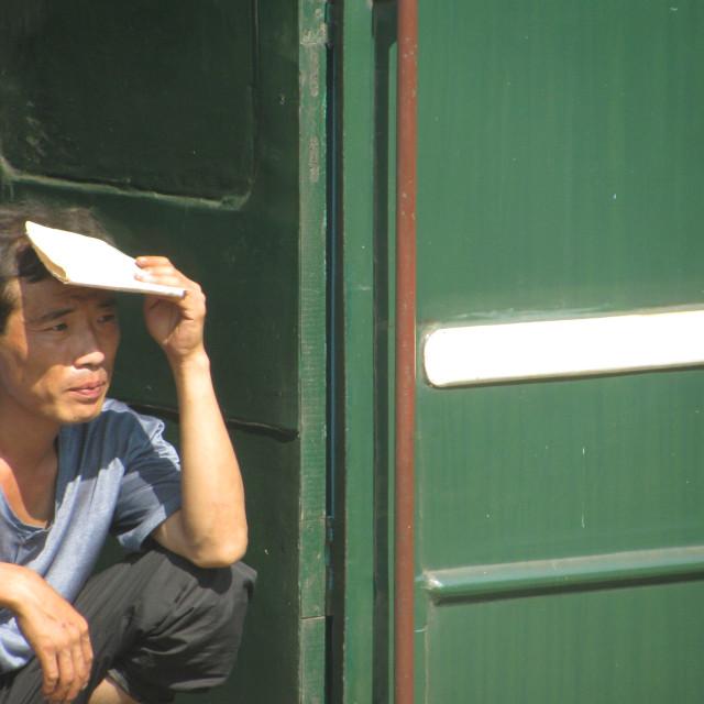 """Man resting in North Korea"" stock image"