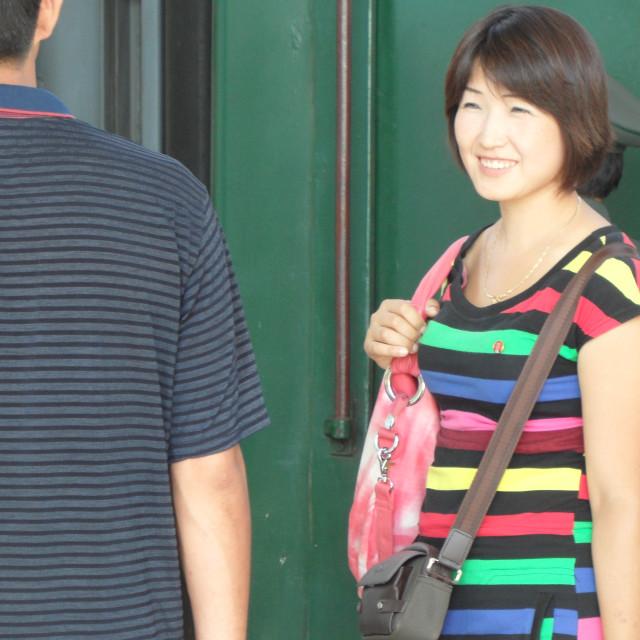 """Woman smiling in North Korea"" stock image"