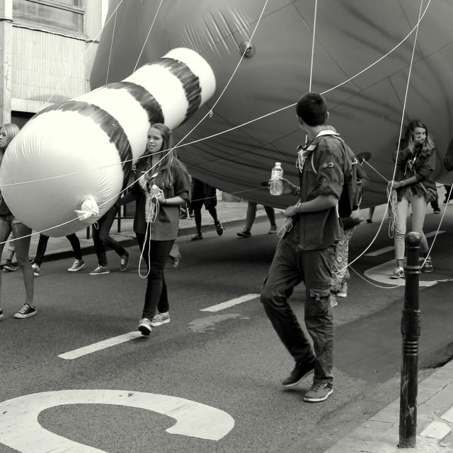 """Walking A Balloon"" stock image"