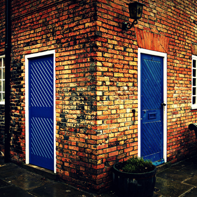 """Two blue doors"" stock image"
