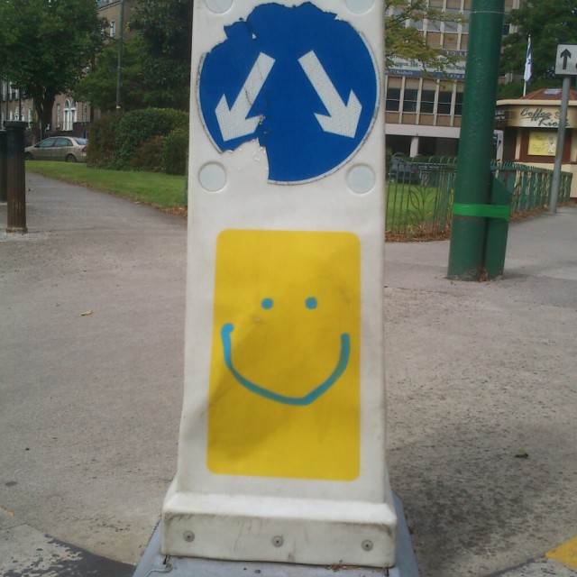 """Smiley-face traffic bollard"" stock image"