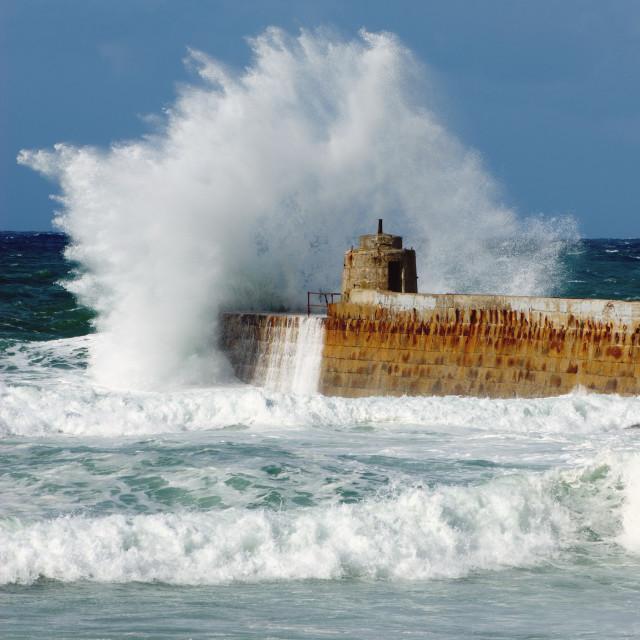 """Big white water wave splash, Portreath pier, Cornwall England."" stock image"