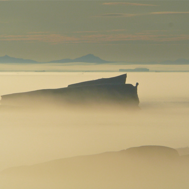 """Iceberg in morning mist"" stock image"
