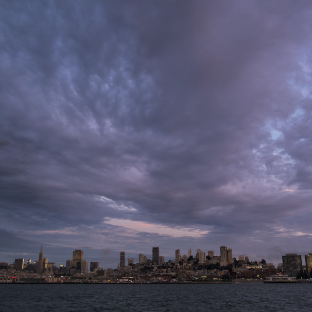 """San Francisco under a cloudy sky at sunset"" stock image"