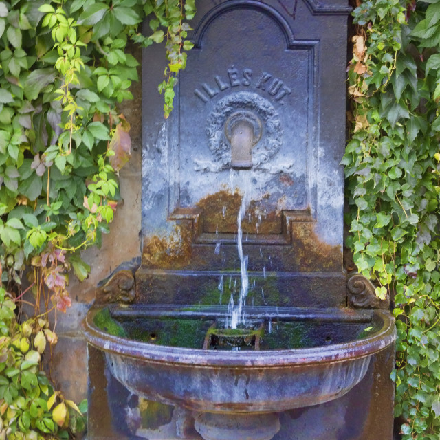 """Ancient drinking fountain"" stock image"