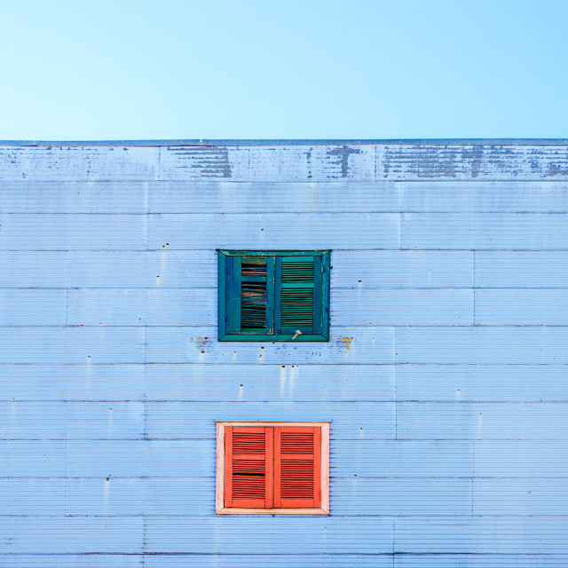 """Blue Facade and Colorful Windows"" stock image"