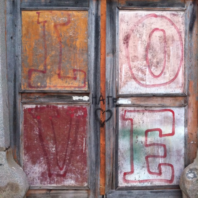 """Love or hate graffiti"" stock image"