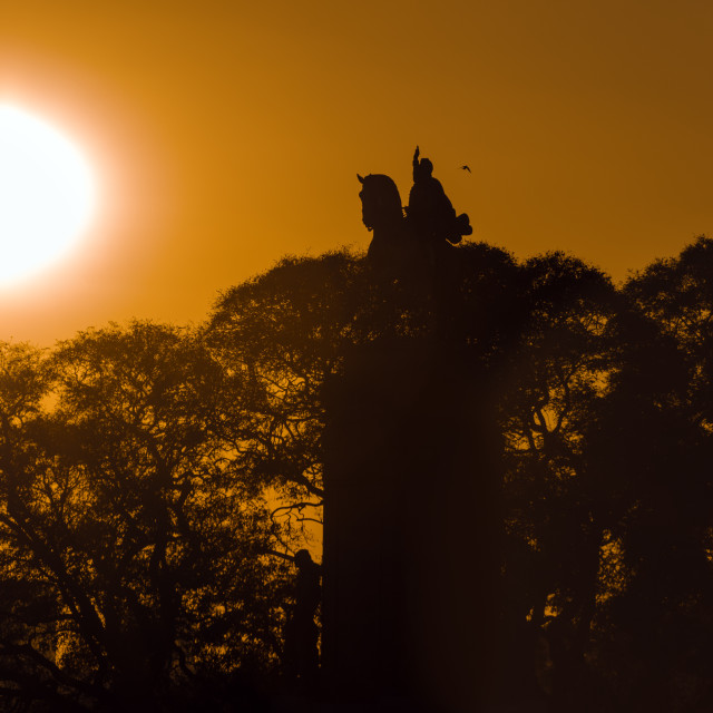 """Statue and Sunrise"" stock image"