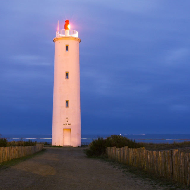 """lighthouse at dawn"" stock image"