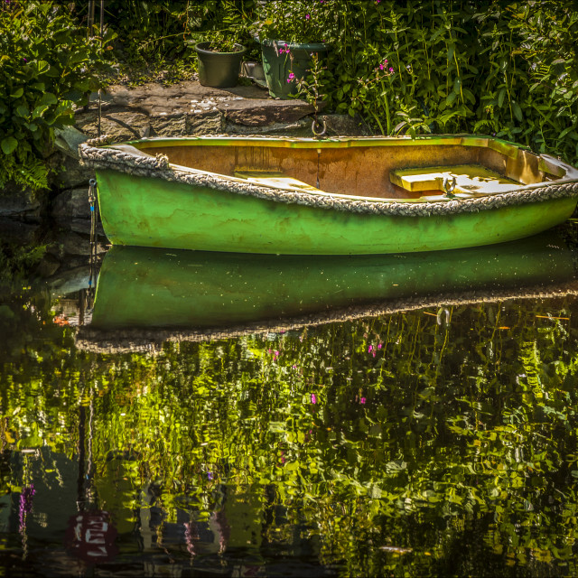 """""""Green Rowing Boat on the Crinan Canal"""" stock image"""