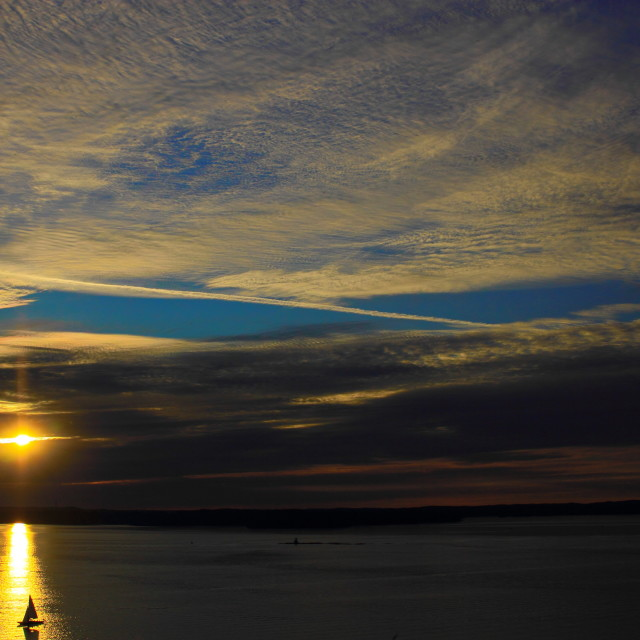 """""""Sailboat and Jet trail at sunset"""" stock image"""