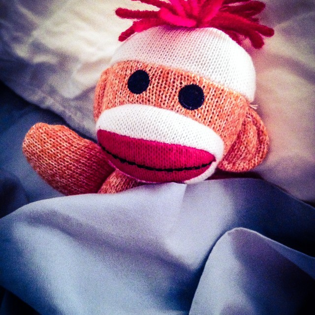 """Orange Sock Monkey ready for bed"" stock image"