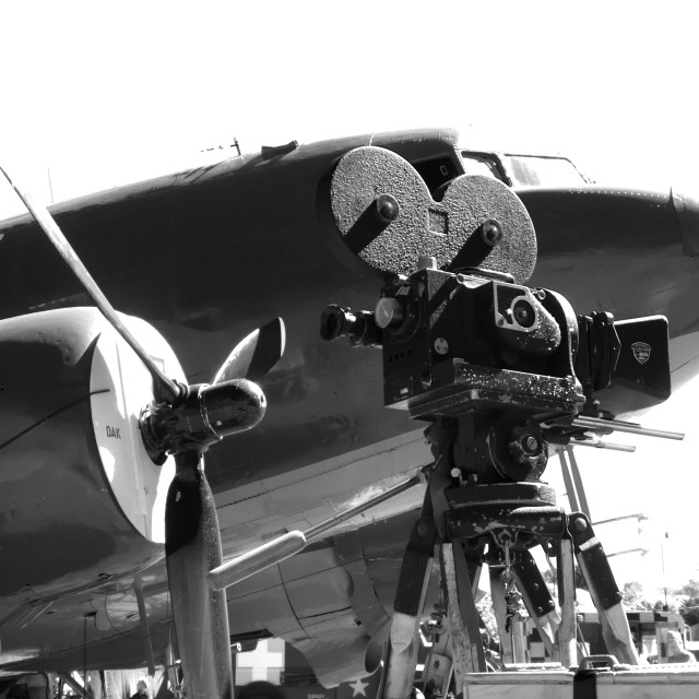 """Movie camera and DC-3 Dakota"" stock image"