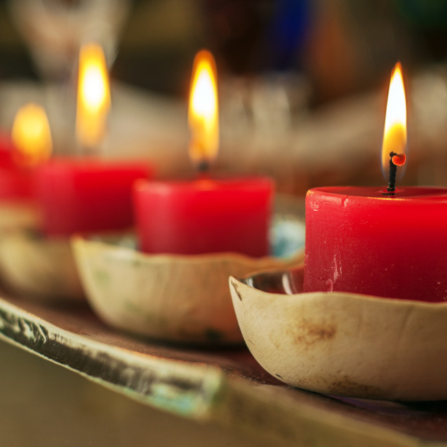 """Closeup Row of Red Candles"" stock image"