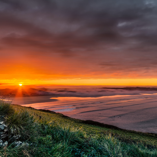 """Early morning mist over Saunton Sands"" stock image"