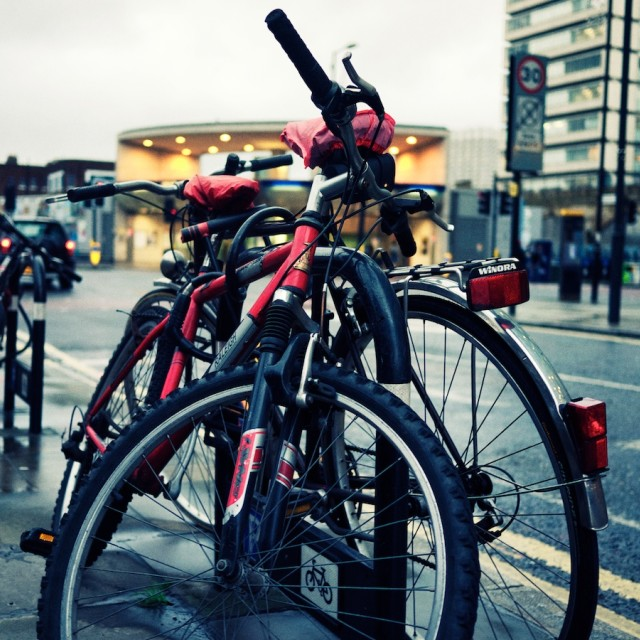 """Bikes in the rain"" stock image"