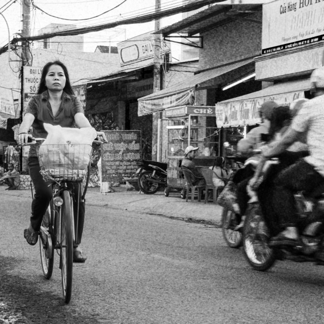 """Cycling home in Saigon, Vietnam"" stock image"