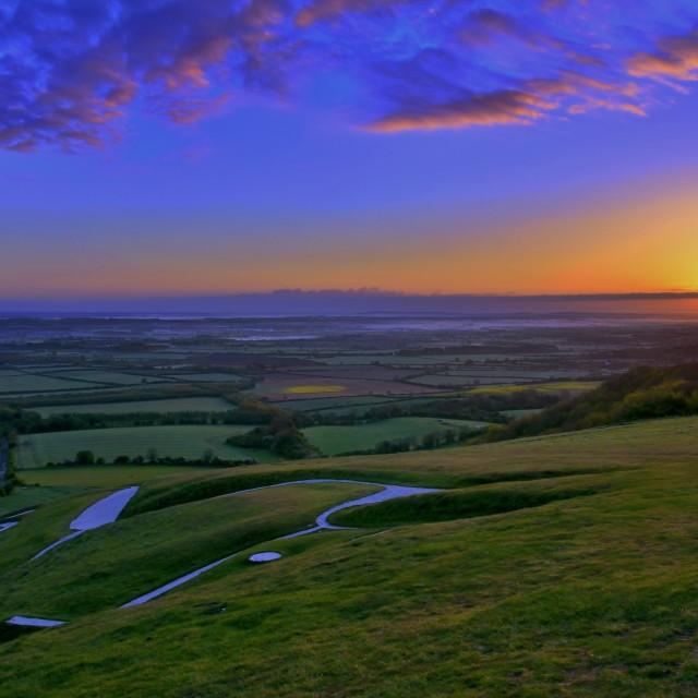 """Sunrise over Uffington Hill"" stock image"