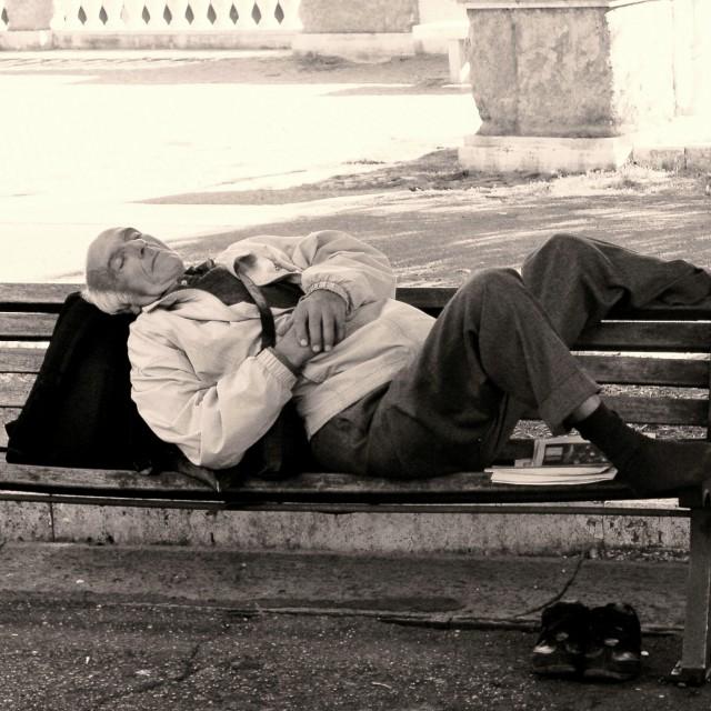 """Asleep on a Bench"" stock image"