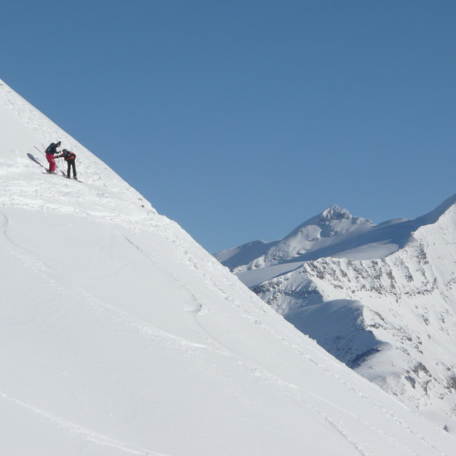 """""""Skiers on a mountain"""" stock image"""