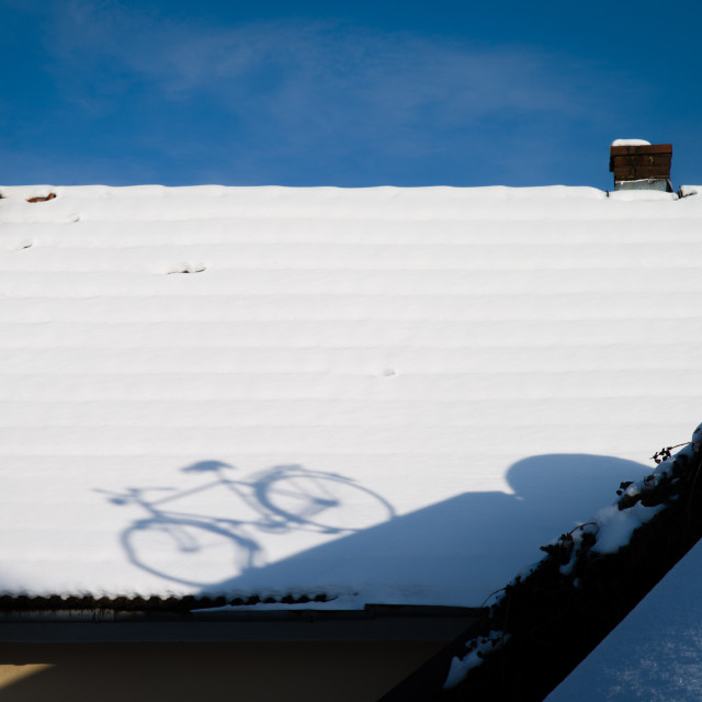 """Bicycle on rooftop"" stock image"