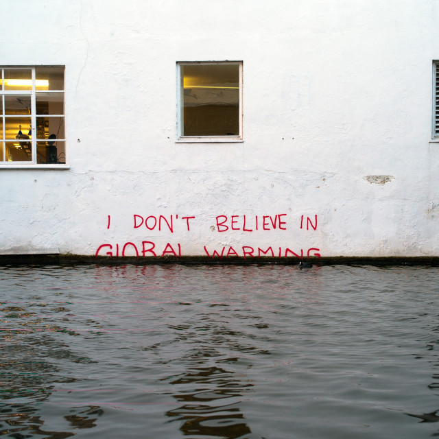 """Banksy: I Don't Believe In Global Warming"" stock image"