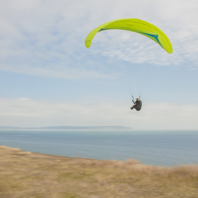 """Para Gliding along the cliffs"" stock image"