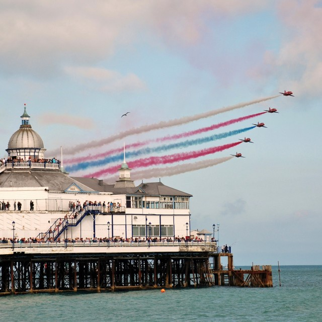"""Reds over the pier, Eastbourne"" stock image"